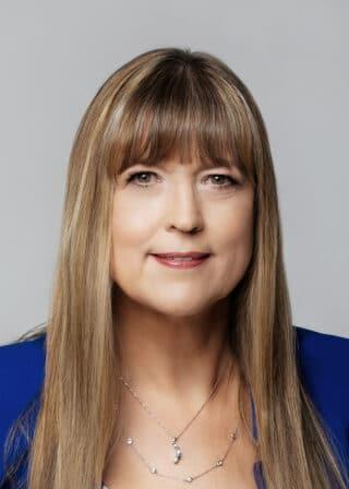 Close-up of Angela Sinickas in 2021