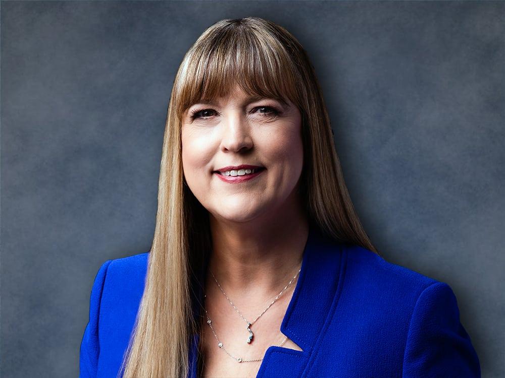 Angela Sinickas wearing a blue suit